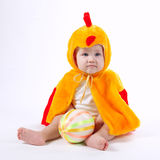 Little funny boy in chicken costume. On white Stock Images