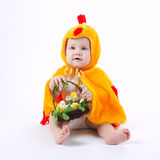 Little funny boy in chicken costume. On white Royalty Free Stock Photography