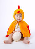 Little funny boy in chicken costume. On white Stock Photography