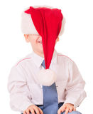 Little funny boy in Christmas red santa hat. On white background Stock Photo