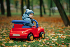 Little funny boy driving toy car. Photo of little funny boy driving toy car Royalty Free Stock Photos