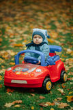 Little funny boy driving toy car. Photo of little funny boy driving toy car Stock Photos