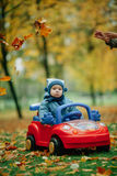 Little funny boy driving toy car. Photo of little funny boy driving toy car Stock Photography