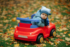 Little funny boy driving toy car. Photo of little funny boy driving toy car Royalty Free Stock Photography