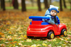 Little funny boy driving toy car. Photo of little funny boy driving toy car Stock Image