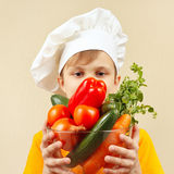 Little funny boy with fresh vegetables Royalty Free Stock Photography