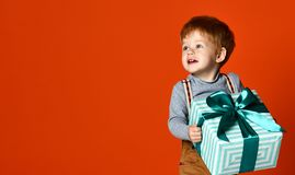 Little funny boy with gift royalty free stock photography