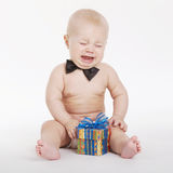 Little funny boy with gift Stock Image