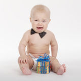 Little funny boy with gift Stock Photography
