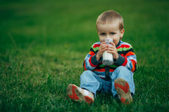 Little funny boy with glass of milk Royalty Free Stock Photography