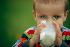 Little funny boy with glass of milk Stock Images