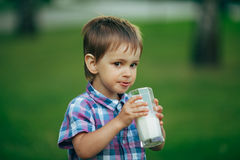 Little funny boy with glass of milk royalty free stock images