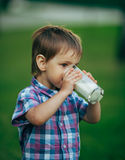 Little funny boy with glass of milk Royalty Free Stock Image