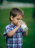 Little funny boy with glass of milk Royalty Free Stock Photos