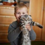Little funny boy hugs cat Royalty Free Stock Photo