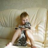 Little funny boy hugs cat Stock Photography