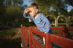 Little boy looks into the distance Royalty Free Stock Image