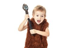 Little funny boy Neanderthal or Cro-Magnon.   portrait. Little funny boy Neanderthal or Cro-Magnon. Ancient savage warrior caveman with ax isolated on white stock image