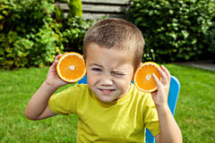 Little funny boy with orange Royalty Free Stock Photo