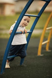 Little boy plays on playground Royalty Free Stock Images