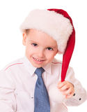 Little funny boy in red santa hat stock photos