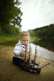 Little funny boy with ship Royalty Free Stock Image