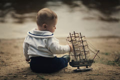 Little funny boy with ship Royalty Free Stock Photography