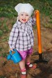 Little funny boy with shovel in garden Stock Photos