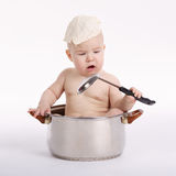 Little funny boy sitting in pan Royalty Free Stock Photography