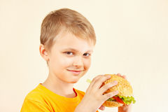 Little funny boy with tasty sandwich Stock Images