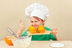 Little funny chef with a cooked appetizing muffin Stock Photography