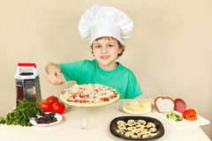 Little funny chef shows how to cook pizza Stock Images