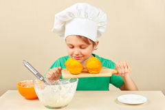 Little funny chef sniffing aroma of cooked cake Royalty Free Stock Photos
