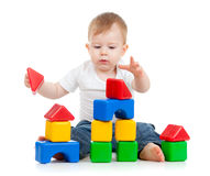Little funny child playing with building blocks. Little boy playing with building blocks stock image