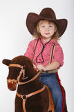 Little funny cowgirl riding horse Royalty Free Stock Images