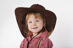 Little funny cowgirl on white background Royalty Free Stock Images