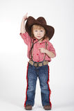 Little funny cowgirl on white background Stock Photo