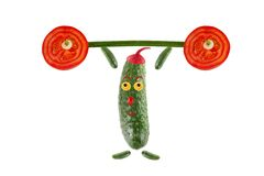 Little funny cucumber raises the bar. Food concept isolated on w Royalty Free Stock Image