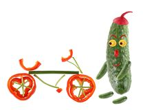 Little funny cucumber standing with bicycle. The picture is made Royalty Free Stock Image