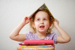 Little funny girl with Books. Concept of education royalty free stock images
