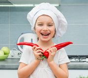 Little girl in with Pepper Royalty Free Stock Photos