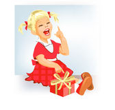 Little funny girl with gift Royalty Free Stock Photography