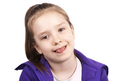 Little funny girl with her tongue out Royalty Free Stock Photo