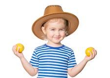 Little Funny girl keeps lemons Royalty Free Stock Image