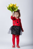 Little funny girl in ladybug costume Royalty Free Stock Photo