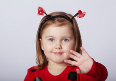 Little funny girl in ladybug costume Stock Images