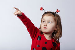 Little funny girl in ladybug costume Royalty Free Stock Image