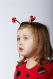 Little funny girl in ladybug costume Royalty Free Stock Photography