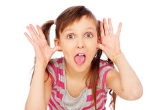 Little funny girl making faces Stock Image