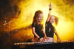 Little girl play on synthesizer in music studio. Little funny girl play on synthesizer in music studio stock image